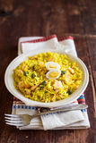 National scottish dish kedgeree with roasted basmati rice, curry powder and fish in a plate Stock Images