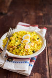 National scottish dish kedgeree with roasted basmati rice, curry powder and fish in a plate Royalty Free Stock Images
