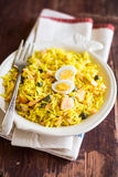 National scottish dish kedgeree with roasted basmati rice, curry powder and fish in a plate Stock Image