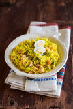 National scottish dish kedgeree with roasted basmati rice, curry powder and fish in a plate Royalty Free Stock Photography
