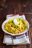National scottish dish kedgeree with roasted basmati rice, curry powder and fish in a plate Royalty Free Stock Photos
