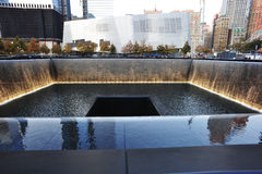 National September 11 Memorial. A view of the National September 11 Memorial with the Freedom Tower being built at the World Trade Center site in New York City Stock Photography