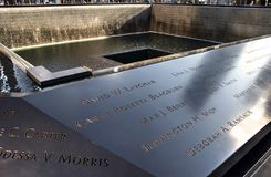 National September 11 Memorial in New York City. Closeup view of NYC`s 9/11 Memorial at World Trade Center Ground Zero. Names of the men, women, and children stock photography