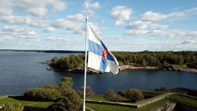 National sign finnish flagstaff waving at cloudy skyline background stock footage