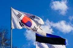 National South Korea flag with official colors waving on the blu. E sky stock photos