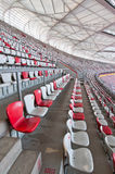 National Stadium. Beijing, China - April 2nd, 2013: rows of white and reds chairs on National Stadium in Chaoyang District, commonly known as Bird's Nest Stock Photo