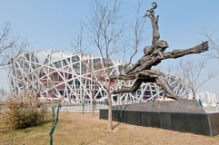 National Stadium. Beijing, China - April 2nd, 2013: Runners statue in front of National Stadium in Chaoyang District, commonly known as Bird's Nest Royalty Free Stock Photo