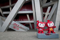 National Stadium. Beijing, China - April 2nd, 2013: 2008 Summer Olympic Games mascots in front of National Stadium in Chaoyang District, commonly known as Bird's Stock Images