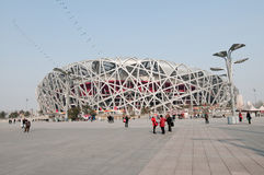 National Stadium. Beijing, China - April 2nd, 2013: Tourists and souvenirs sellers in front of National Stadium in Chaoyang District, commonly known as Bird's Stock Photo