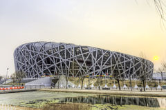 National Stadium Sunset. The sun sets behind the National Stadium in Beijing's Olympic Park Stock Photo
