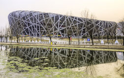 National Stadium Sunset. The sun sets behind the National Stadium in Beijing's Olympic Park Royalty Free Stock Image