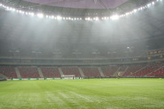National Stadium in Warsaw. WARSAW, POLAND - FEBRUARY 28: An attempt to light the National Stadium in Warsaw the day before the friendly football match Poland Stock Photos