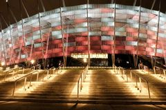 National Stadium in Warsaw illuminated at night by national colors Royalty Free Stock Photo