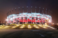 National Stadium in Warsaw illuminated at night Stock Photos
