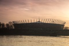 National Stadium in Warsaw during sunset. National Stadium in Warsaw, Poland, and Vistula river during sunset royalty free stock photos
