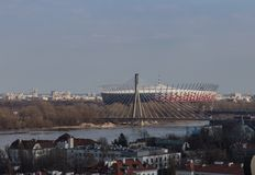 National Stadium in Warsaw and Swietokrzyski bridge. National Stadium in Warsaw, Poland, and Swietokrzyski bridge over Vistula river royalty free stock image
