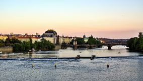 National Theater, Vltava River, Prague, Czech Republic. Sunset over National Theater on waterfront of River Vltava in Prague, Czech Republic Royalty Free Stock Images