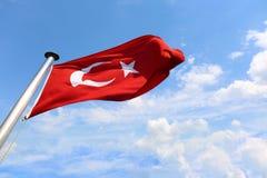 National Turkish flag fluttering. Against blue sky stock photo