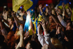 National ukrainian attributes at a rock band concert. Fans are lifting hands up with flags and flower crowns in the name of Ukraine at a concert of a ukrainian Royalty Free Stock Photo