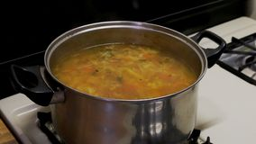 National ukrainian borsch cooking vegetable soup on the plate board. On the red background stock footage