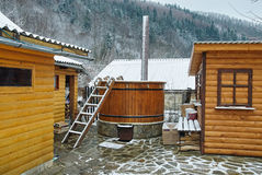National Ukrainian wooden water spa hot tub. With stairs in winter royalty free stock photography