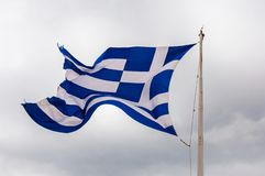 National vibrant blue and white flag of Greece fluttering waving flying in the wind on the flagpole. Athens, Greece - June 12, 2013: National vibrant blue and royalty free stock image