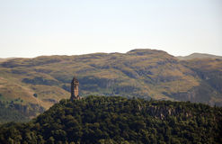 The National Wallace Monument. Generally known as the Wallace Monument is a tower standing on the summit of Abbey Craig, a hilltop overlooking Stirling in Stock Photos