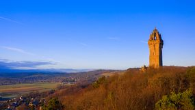 The National Wallace Monument is a tower standing on the shoulder of the Abbey Craig, a hilltop overlooking Stirling in Scotland. It commemorates Sir Will royalty free stock photography
