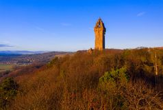 The National Wallace Monument is a tower standing on the shoulder of the Abbey Craig, a hilltop overlooking Stirling in Scotland. It commemorates Sir William stock image