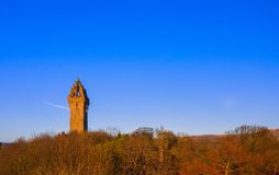 The National Wallace Monument is a tower standing on the shoulder of the Abbey Craig, a hilltop overlooking Stirling in Scotland. It commemorates Sir William stock photos