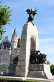 National War Memorial and Chateau Laurier Hotel in Ottawa. Ottawa, Canada - August 8, 2008: National War Memorial designed by Vernon March and unveiled by King royalty free stock photo