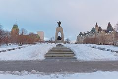 National war memorial, Ottawa, Canada. National war memorial on a winter day with snow, Ottawa, Canada, , designed by Vernon March stock images