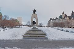 National war memorial, Ottawa, Canada. National war memorial on a winter day with snow, Ottawa, Canada, , designed by Vernon March stock image