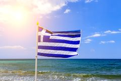 National waving Greek flag and mediterranean sea. Greek flag at back of Blue sky background aegean sea. . Greece flag is. National waving Greek flag and royalty free stock photography
