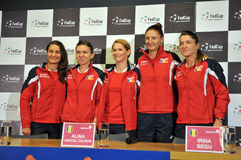 National Women Tennis Team of Romania during a press conference. CLUJ-NAPOCA, ROMANIA - APRIL 13, 2016: The Tennis Women Team of Romania posing during the press Royalty Free Stock Image