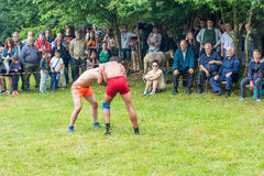 On national wrestling at the Nestinar Games in Bulgaria. Bulgaria is the only country in the world where barefoot people dance on red-hot charcoal. The village Stock Images
