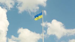 The national yellow and blue flag of Ukraine over the sky and clouds stock video footage