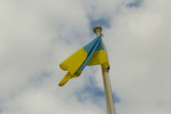 National yellow and blue flag of Ukraine over the sky and clouds Royalty Free Stock Images