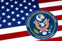 Nationale Terroristenbekämpfungs-Mitte-Dichtung und die US-Flagge Lizenzfreie Stockbilder