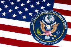 Nationale Terroristenbekämpfungs-Mitte-Dichtung und die US-Flagge Lizenzfreies Stockfoto