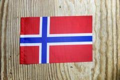 Nationale textielvlag op houten lijst Royalty-vrije Stock Foto's