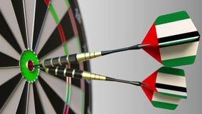 Nationale voltooiing Vlaggen van de Verenigde Arabische Emiraten de V.A.E op pijltjes die bullseye raken Het conceptuele 3d terug Royalty-vrije Stock Afbeeldingen