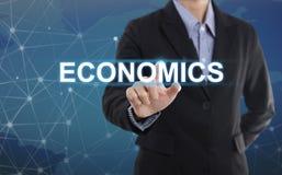 Nationalekonomi för knapp för trycka på för affärsmanhand arkivbild