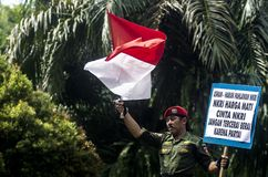 NATIONALISM CAMPAIGN. A man are carrying signs on a campaign to promote higher nationalism among Indonesians royalty free stock image