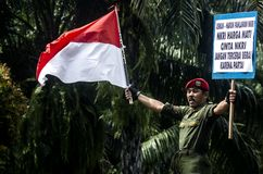 NATIONALISM CAMPAIGN. A man are carrying signs on a campaign to promote higher nationalism among Indonesians stock images