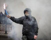 Nationalist groups burn flares during March of Dignity in Kiev. KIEV, UKRAINE - Feb 22, 2017: Activists of nationalist groups burn flares outside the building of Royalty Free Stock Photography