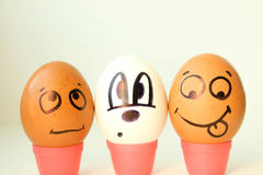 Nationality concept. Eggs with painted face. blac Royalty Free Stock Photos