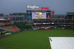 Nationals Park Scoreboard - Washington, DC. Nationals fans arriving for a night baseball game Stock Photography