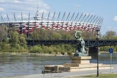 Nationell stadion och staty av sjöjungfrun i Warszawa, Polen Arkivbilder
