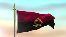 Nationsflagga av Angola som vinkar i vinden mot ultrarapiden för solnedgånghimmelbakgrund